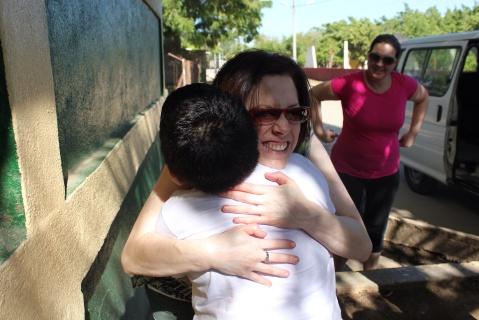 Hugging a sponsored child